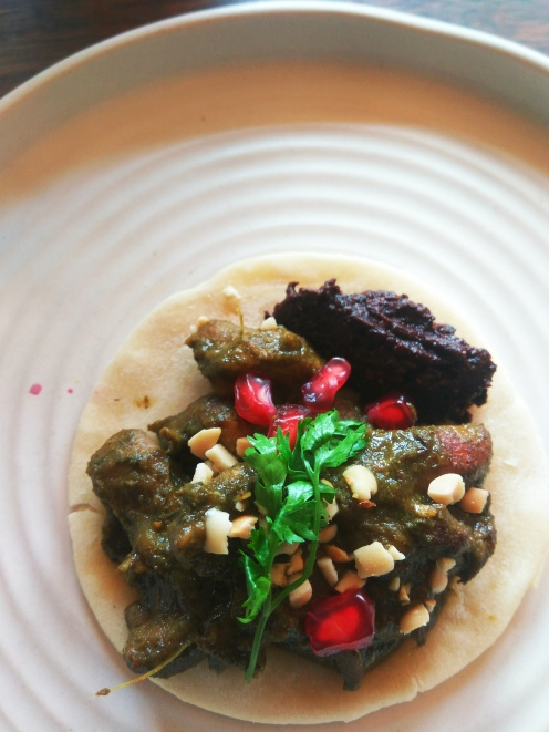 Chicken cafreal, pomegranate, roasted cashew nuts, soft tortilla